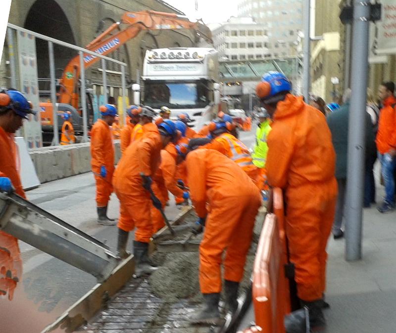 Pouring concrete to make pavement extension