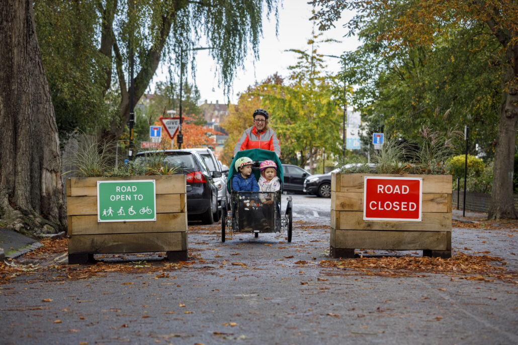 Mother with two children in a cargo bike